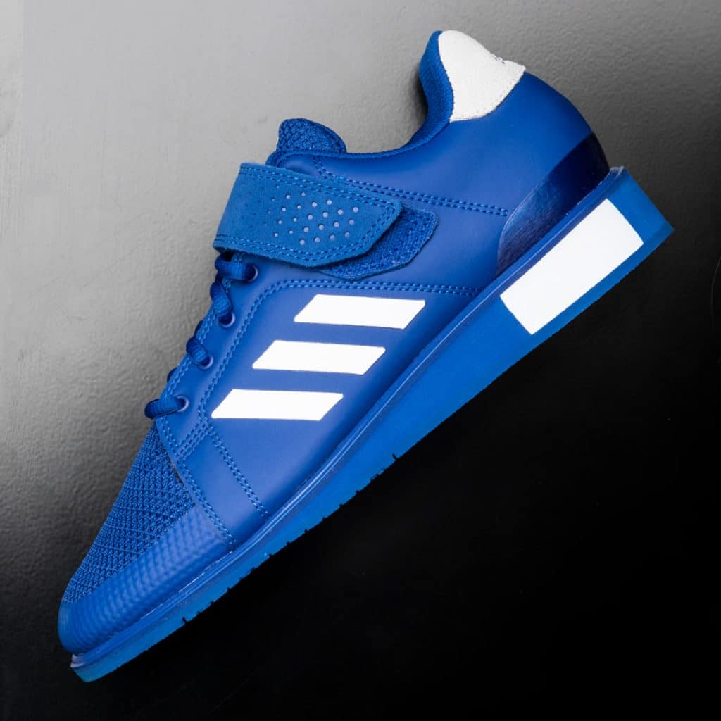 The Men's Power Perfect 3 from Adidas is a specially engineered, weightlifting-specific shoe equipped with a die-cut wedge midsole, integral heel support, and a hook-and-loop instep strap. The result is an optimized, stable platform suited to the needs of even the most high intensity weightlifter, with surprising comfort and breathability built in.