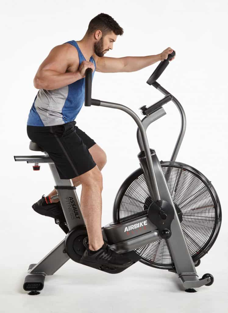 An Air Bike, such as the Airbike Elite from Precor, also incorporates your upper-body through the use of push and pull handles. This turns something that is traditionally just a lower-body workout into a low-impact, total body workout.