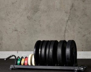 American Barbell Horizontal Rolling Bumper Storage full view with plates