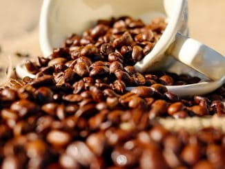 Coffee beans spilling from a cup - What are the health benefits of coffee?