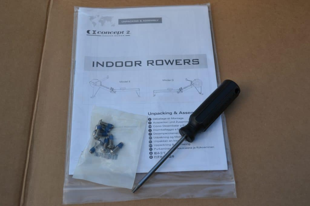 A small number of screws, screwdriver, and assembly instructions - all that you need to assemble a Concept 2 Model D indoor rower for your home or garage gym.