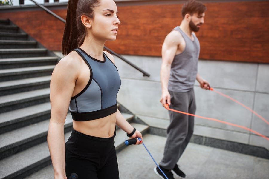 A couple working out with jump ropes - Jumping rope works great with tabata.