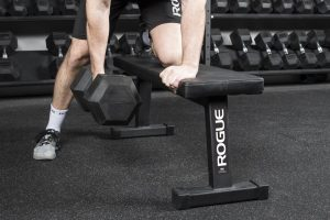 Dumbbell rows on a flat bench - a staple of muscle and strength building workouts for the ages