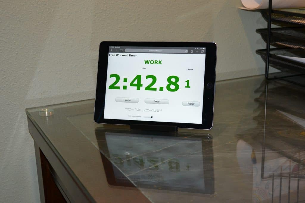 The Fit At Midlife Free Workout Timer works great with an iPad and tablet stand to make a great, low-cost gym, fitness, or exercise timer.