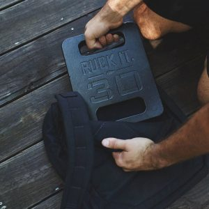 GORUCK weights - the GORUCK 30 lb ruck plate being placed into a ruck