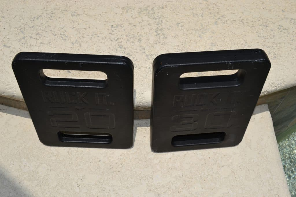 GORUCK Ruck Plates - a 20 Lb Plate and 30 Lb Plate side by side. Notice the 30 lb plate is same height and width, but thicker.