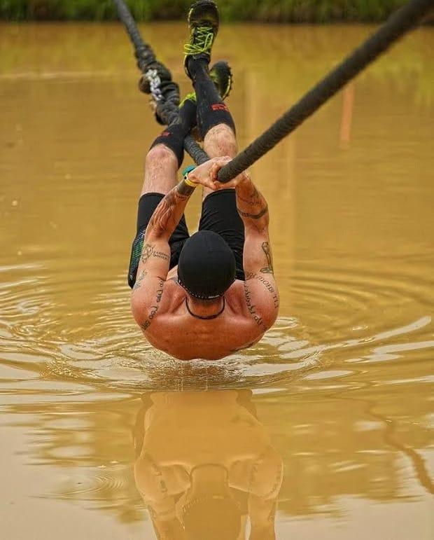 MudGear Tall Compression Socks Black Orange on the traverse