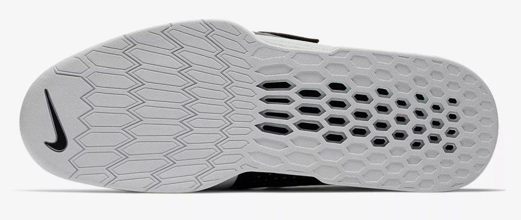 Sole of the Nike Romaleos 3 XD - Mens - Designed for elite-level lifting, the Nike Romaleos 3 XD features a honeycomb-patterned plate for stability, while Flywire technology and a dynamic strap provides a supportive fit during your workout.