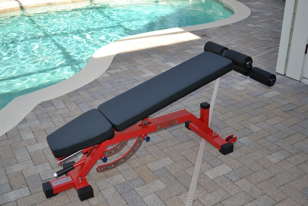 REP AB-5000 Adjustable FID Bench in decline mode using the optional leg attachment accessory.