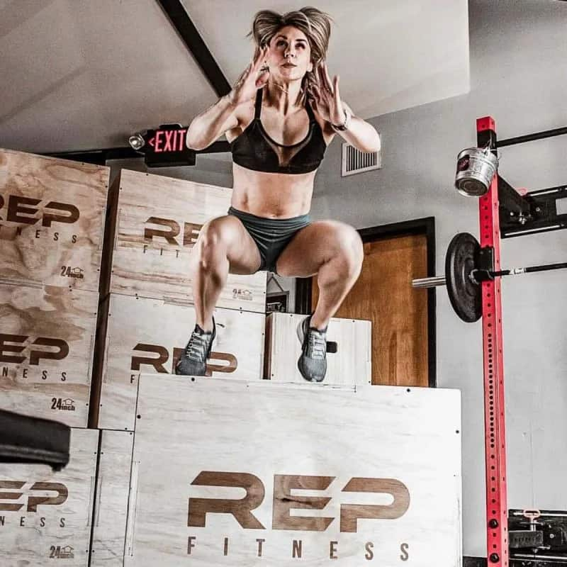 Rep Fitness 3-in-1 Wood Plyo Boxes with a human