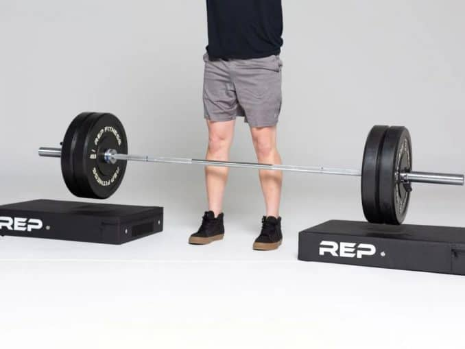 Rep Fitness Drop Pad under a barbell pair