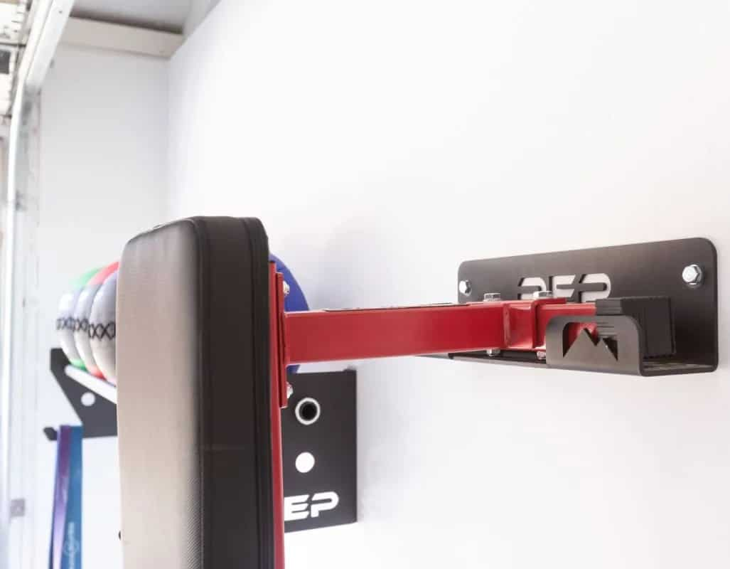 Rep Fitness FB-3000 Flat Bench attached on the wall