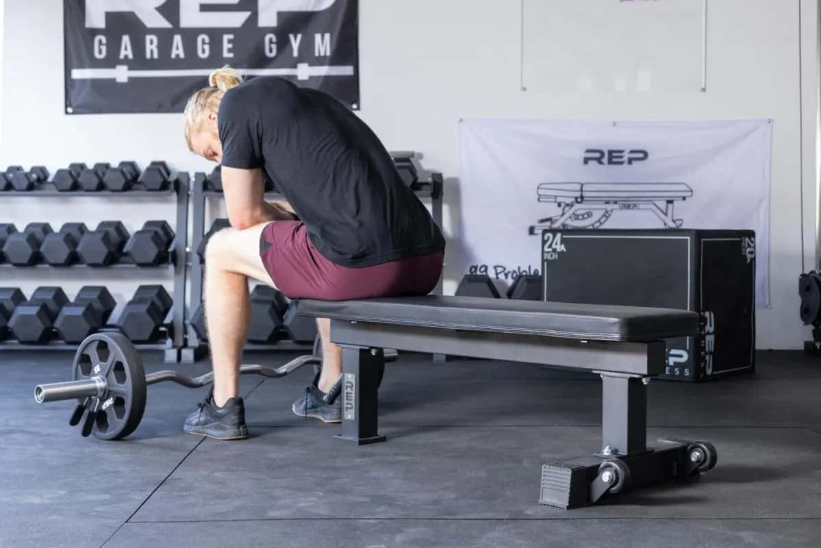 Rep Fitness FB-4000 Comp Lite Bench with a user 1