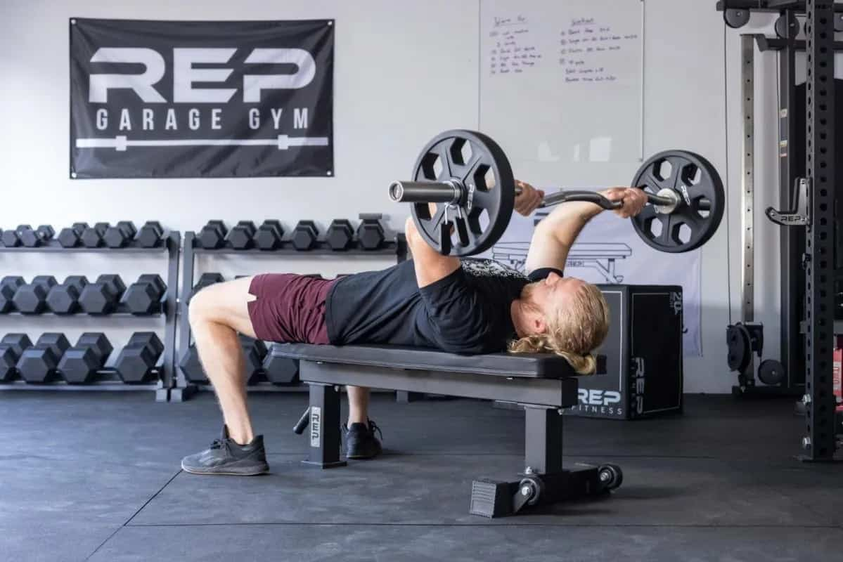 Rep Fitness FB-4000 Comp Lite Bench with a user 2
