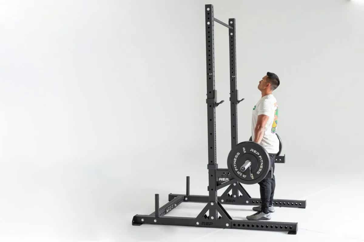 Rep Fitness SR-4000 Squat Rack side view carrying barbell