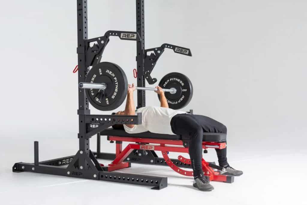 Rep Fitness SR-4000 Squat Rack to lift barbell side view
