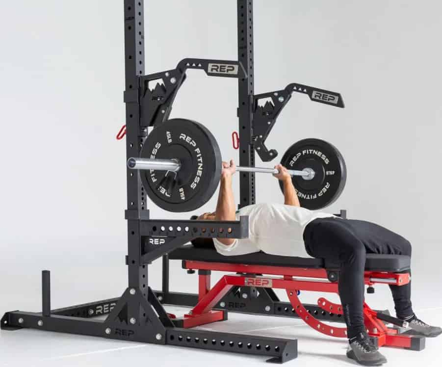 Rep Fitness SR-4000 Squat Rack to lift barbell side view-crop