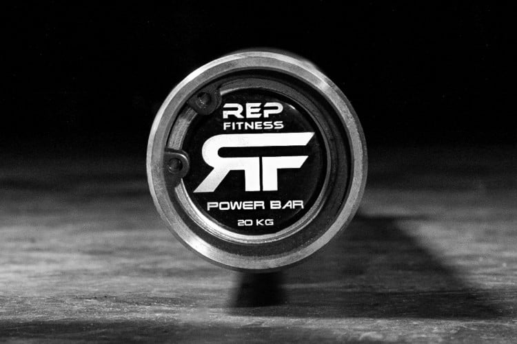 Snap ring endcap and logo on the Rep Fitness Power Bar v2 - made with Stainless Steel