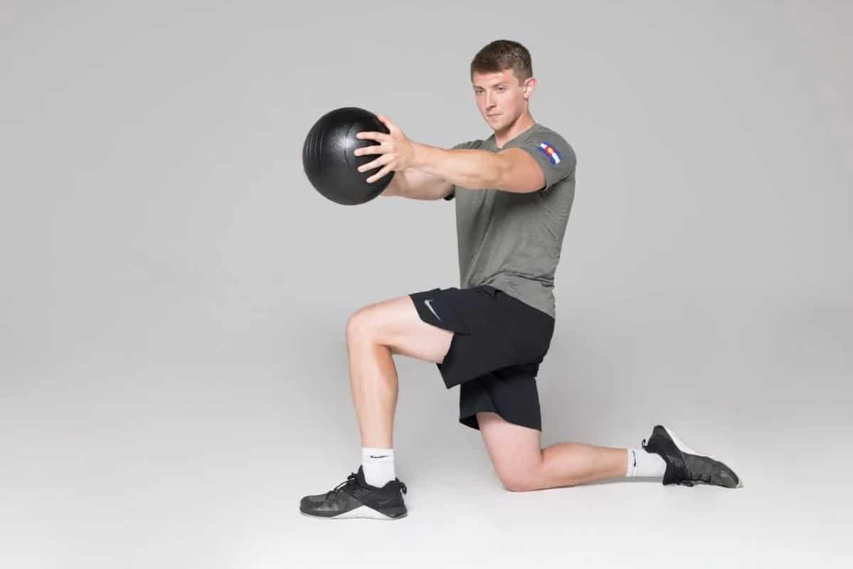 Rep Fitness V2 Slam Balls lunge man