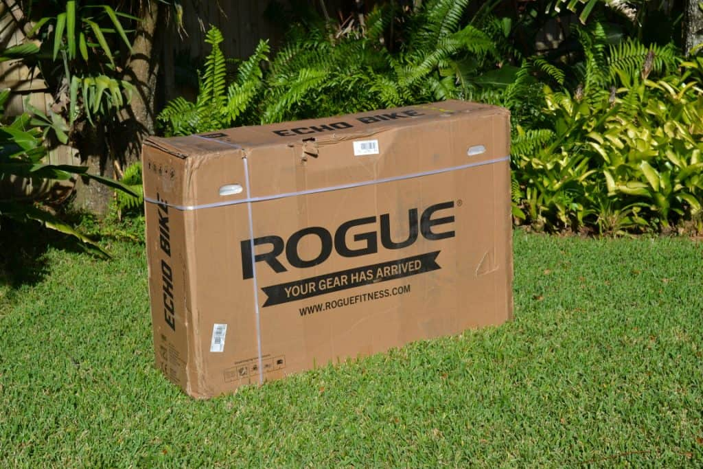 Shipping container for the Rogue Fitness Echo Bike. It is packaged very securely. The box has lifting handles on either end. It is about 67.5 kgs / 148 lbs.