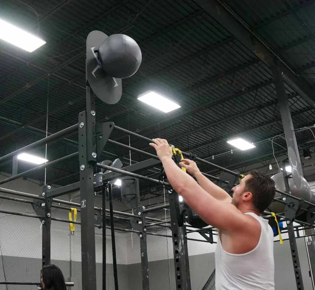 Torque Fitness Wall Ball Target with a user 1