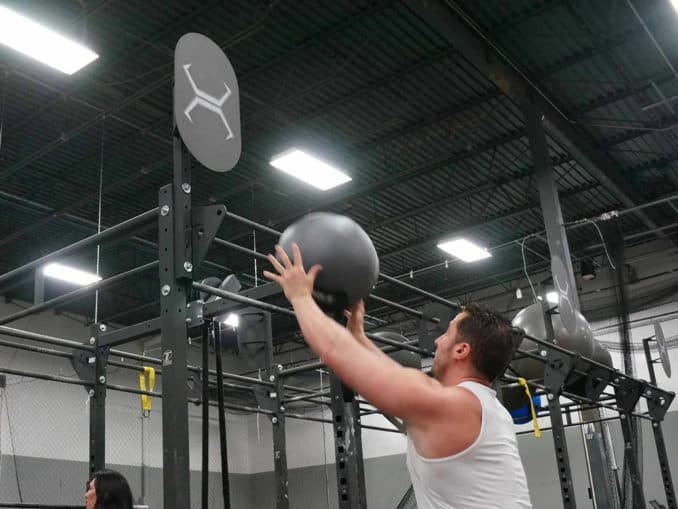 Torque Fitness Wall Ball Target with a user