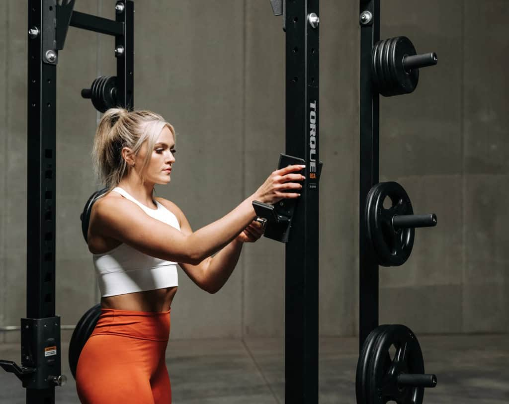 Torque USA Wall-Mounted Squat Rack Slim with a user 2