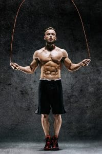 An athlete workout out with a jump rope (or skipping rope). Jumping rope is a fierce calorie burning exercise that is fun, easy to do, and can be done almost anywhere. Great for weight loss.