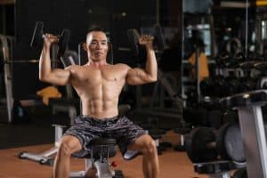 A good adjustable bench can be used for seated and back supported exercises such as the dumbbell press