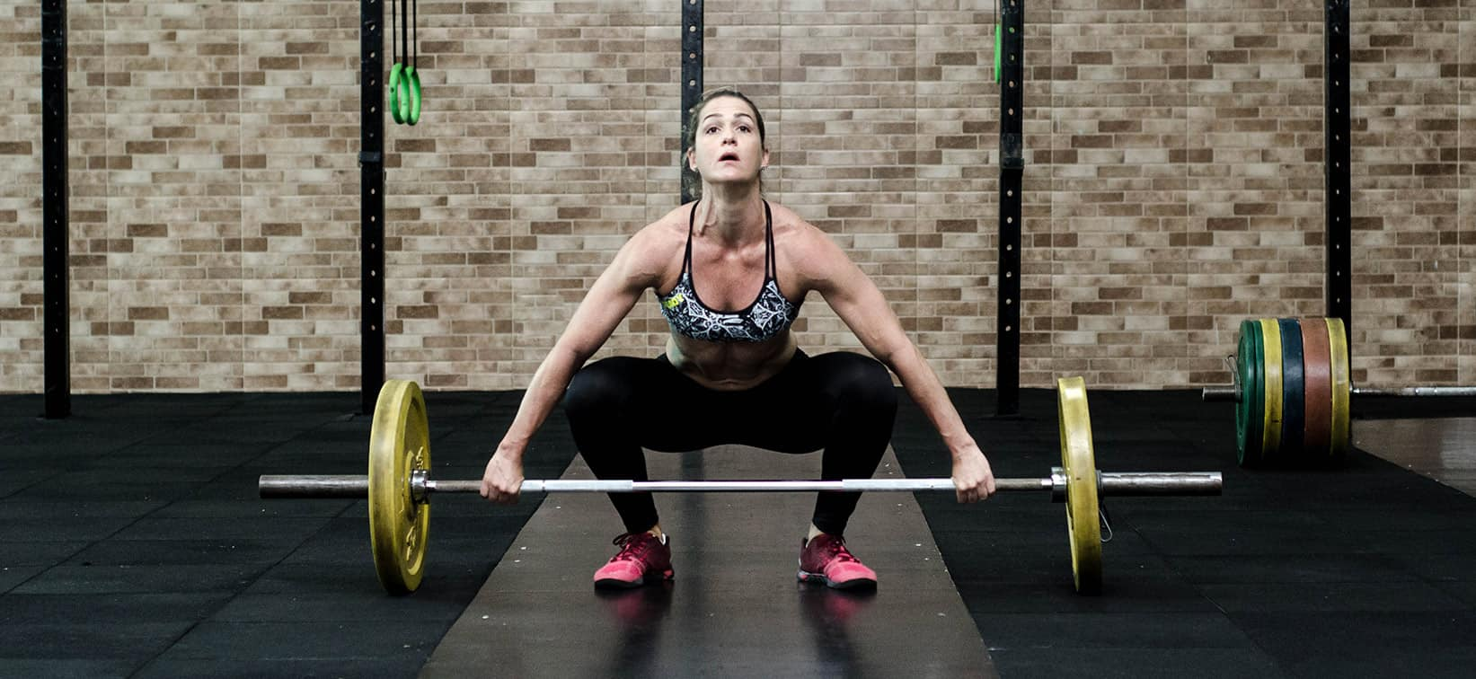 Snatch - an olympic weightlifting exercise performed with a barbell.