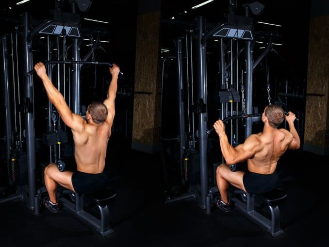 A man performs a lat pulldown exercise on a machine