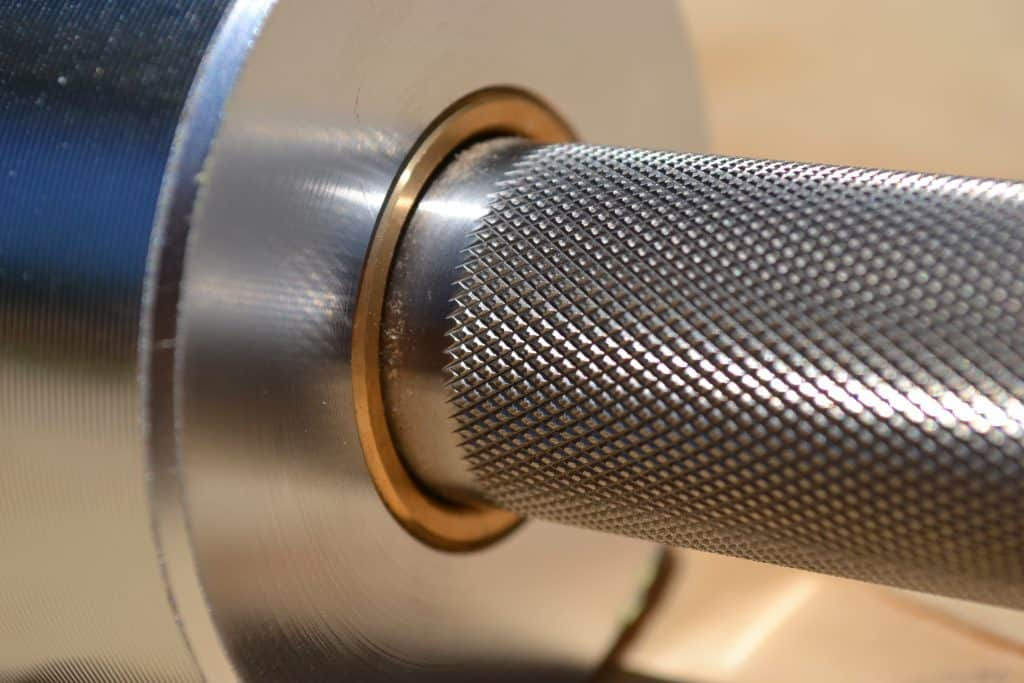 Closeup of sleeve and knurl on boneyard bar