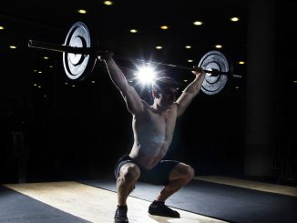 Performing a snatch - one of the olympic lifts