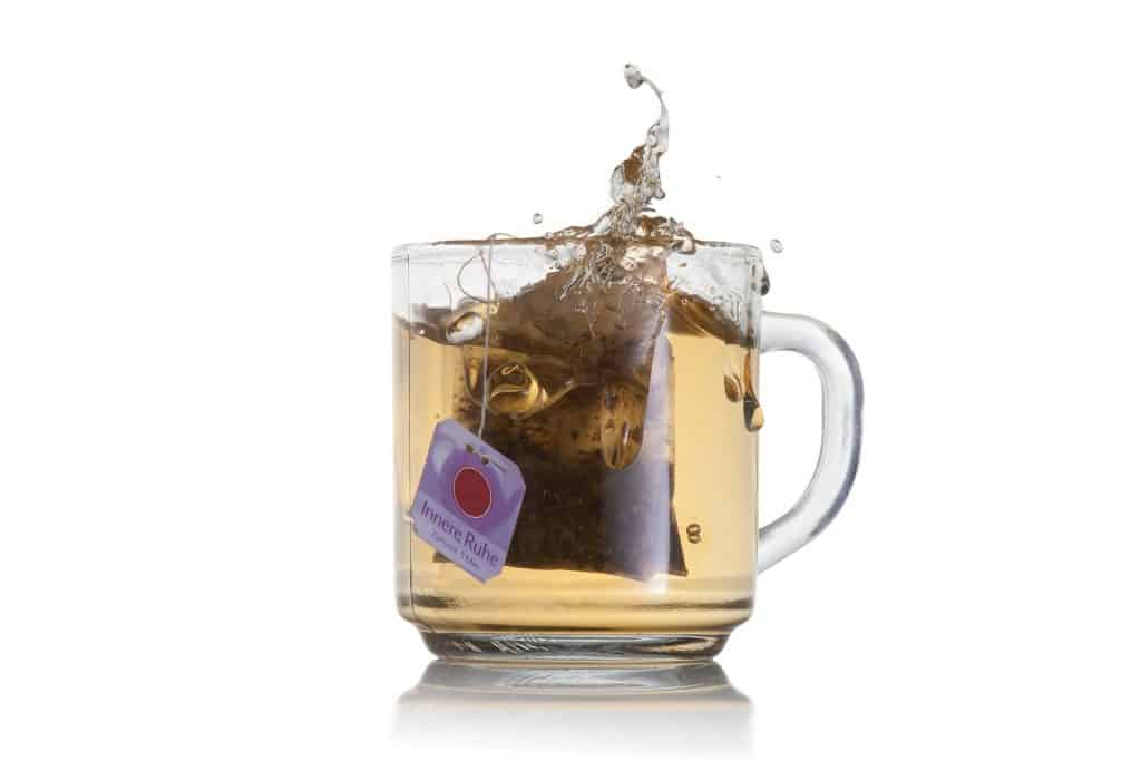 A cup of tea with a tea bag - low-calorie healthy beverage