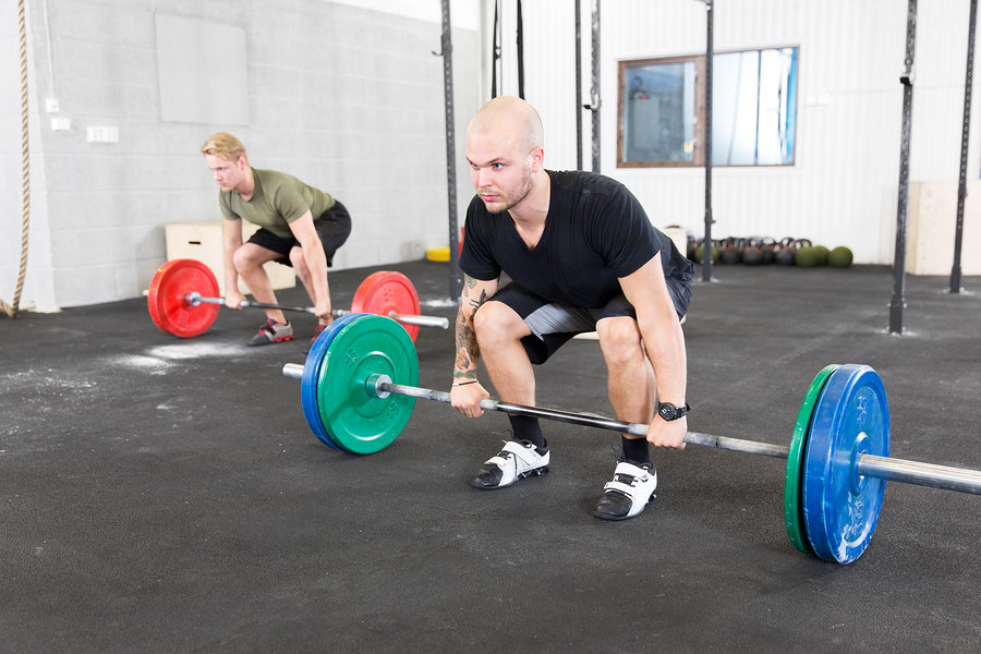 Deadlifting can be done in weightlifting shoes - but is not strictly necessary to wear them, as there is less need for ankle range of motion.