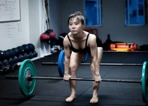 The Deadlift - a lift you can do in bare feet - with minimal knee flexion and ankle range of motion some people to choose to deadlift this way.