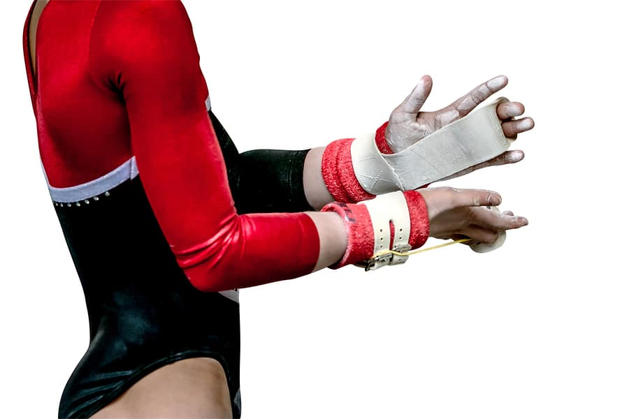 Female gymnast with chalk and hand grips