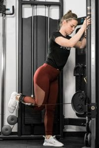 Using the ankle straps means the lower body can also be worked out on the functional trainer or cable machine.  Here a leg curl is demonstrated using the ankle strap.