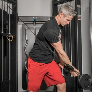 The big benefit of the functional trainer machine? Do movements such as the chop and train your core and anti-rotation work.