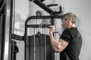 Full body workout is possible with a cable machine like a functional trainer or cable crossover - as long as you have the right attachments. Here is a biceps curl.