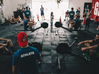 A photo showing Concept2 indoor rowers in use at a CrossFit box - indoor rowing is an excellent exercise.