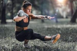 The pistol squat is hard. Make it even harder with the addition of a kettlebell. This trainee exhibits impeccable form.