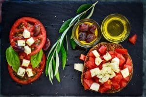 The Mediterranean diet is a diet inspired by the eating habits of people living in the Mediterranean - which includes Greece, Southern Italy, and Spain The principal aspects of this diet include high consumption of olive oil, legumes, unrefined cereals, fruits, and vegetables, high consumption of fish, moderate consumption of dairy (mostly as cheese and yogurt), moderate wine consumption, and low consumption of non-fish meat products, such as beef.