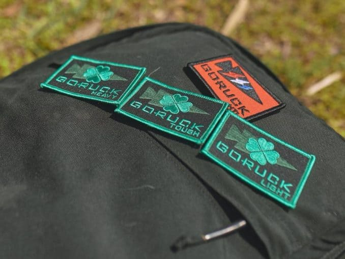 A GORUCK rucksack with event patches.