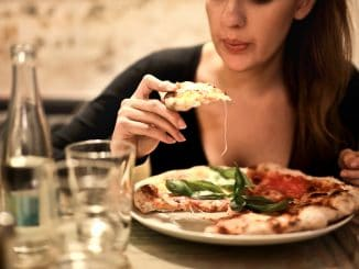 Pizza on a diet? OK IIFYM - If It Fits Your Macros - a type of flexible dieting that is based on portions of macronutrients instead of food restrictions. You still need a caloric deficit.