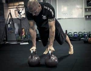 Renegade rows (also called plank rows) using kettlebells.  Alternate lifting one bell at a time.