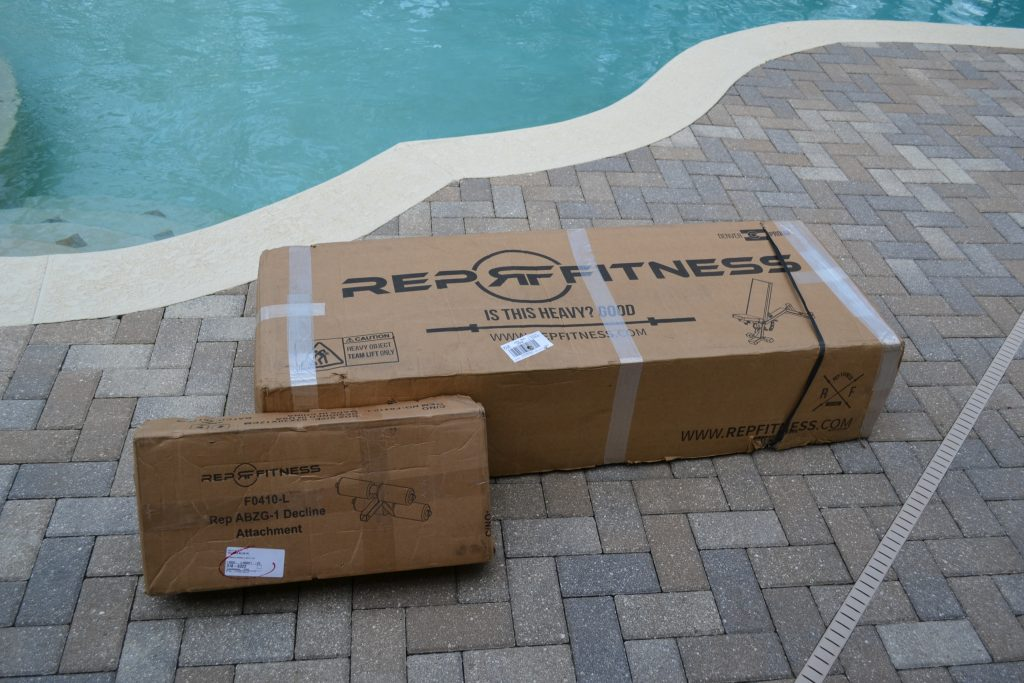 REP AB-5000 Adjustable Bench from Rep Fitness - comes in robust packaging.  Its shipping weight is about 45 Kgs, according to the labels.  Also shown is the optional decline leg accessory.