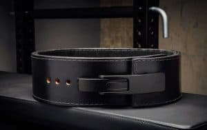 Made in the USA from 100% genuine sole leather, the Rogue Black 13mm Lever Belt is a variation on their original 13mm Powerlifting Belt, utilizing a new, patented lock-in lever design (made from nickel-plated steel) in place of a traditional buckle. This durable belt is uniquely murdered out with a matte-black lever, black hardware, a black suede liner, and an embossed Rogue logo. The edges are beveled for added comfort, and the liner helps prevent any movement or slippage as you train.