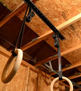 The weight bearing hanger is the professional solution for hanging your gymnastics rings, maximizing space and versatility in your garage or warehouse.