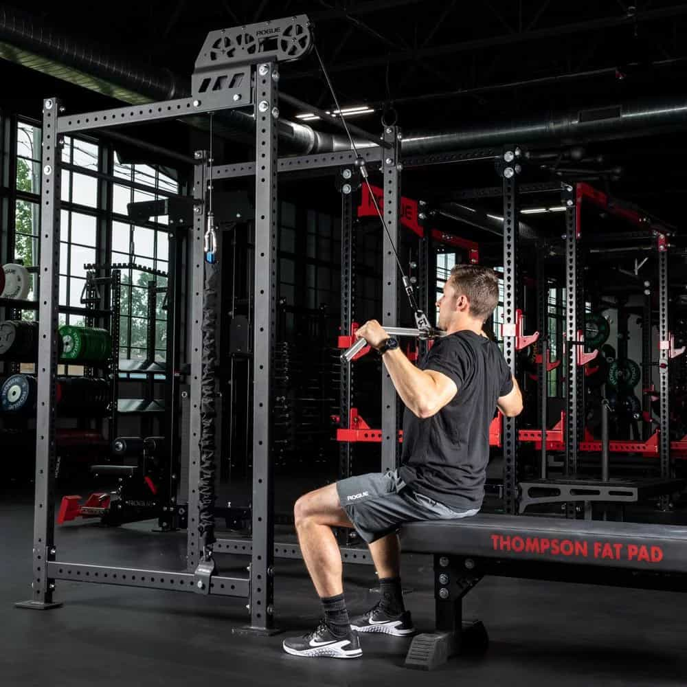 With a weight bench, the Infinity Slinger can be used for light lat pulldowns (there are no leg rollers.)